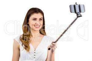 Pretty woman using a selfie stick