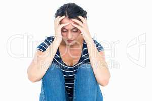 Unhappy woman sitting on the floor