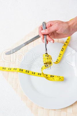 Measuring tape around the fork