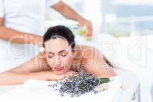 Smiling woman getting an aromatherapy treatment