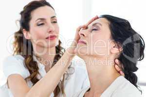 Therapist hypnotizing her patient