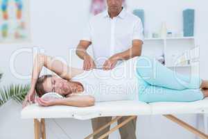 Doctor massaging his patient