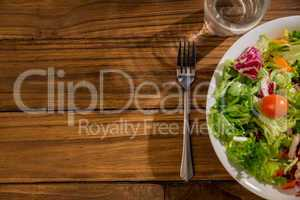 Healthy salad and glass of water