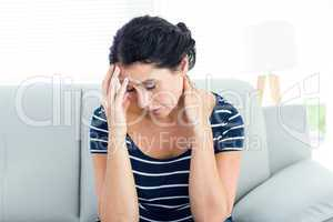 Unhappy woman sitting on the couch