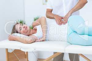 Doctor massaging his patient stomach
