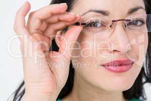 Pretty brunette wearing eye glasses