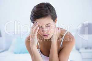 Beautiful brunette suffering from head ache