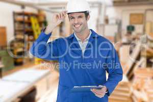 Composite image of happy supervisor wearing hard hat while holdi