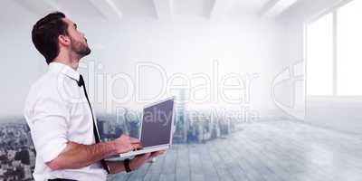 Composite image of sophisticated businessman standing using a la