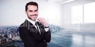 Composite image of stylish businessman smiling at camera
