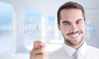 Composite image of happy businessman holding white cable
