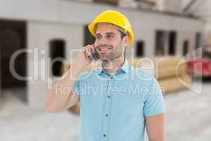 Composite image of happy male architect conversing on mobile pho