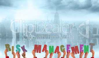 Composite image of hands holding up risk management