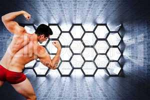 Composite image of attractive bodybuilder