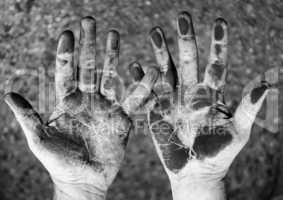 dirty hands on black and white