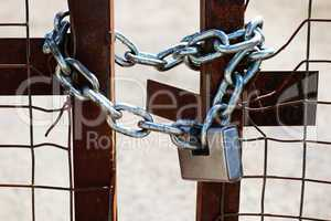Padlock and chain on a gate