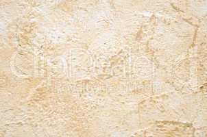 Wall with light brown plaster