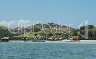 Floating Huts Along Beach Shoreline