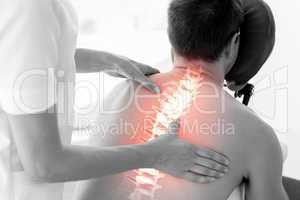 Highlighted spine of man at physiotherapy