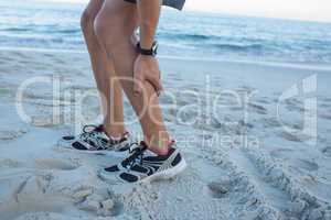 Fit man having muscle pain