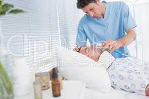 Doctors holding patients oxygen mask