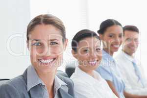 Smiling business people looking at camera