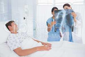 Doctors examining patients xray