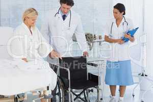Patient trying to sit on wheelchair