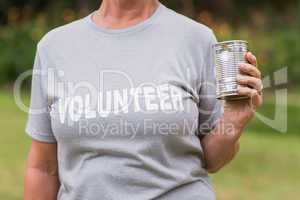 Volunteer holding tin can