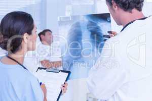 Doctors checking patients xray
