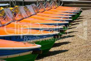 Pedal boats in a row