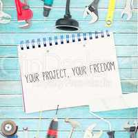 Your project, your freedom against tools and notepad on wooden b