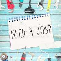 Need a job? against tools and notepad on wooden background