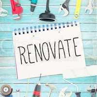 Renovate  against tools and notepad on wooden background