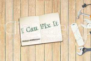 I can fix it against tools and notepad on wooden background