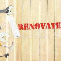 Renovate  against tools on wooden background