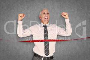 Composite image of businessman winning race