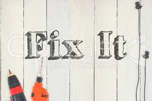 Fix it against diy tools on wooden background