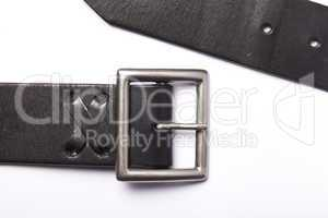 Belt with a fastener isolated