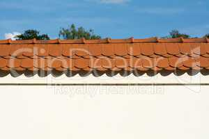 Wall with red roof