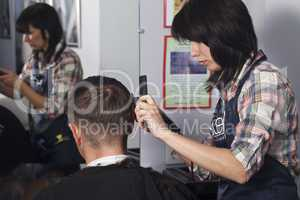 The master the hairdresser does a hairdress