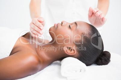Pretty woman enjoying a reiki technique