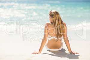Wear view of blonde woman looking at the sea
