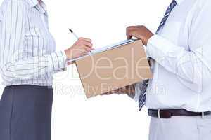 Businesswoman signing papers for package
