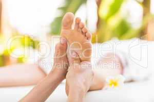 Close-up of a woman receiving foot massage
