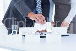 Business people working together and building structure