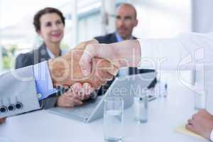Interview panel shaking hands with applicant