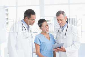Doctors speaking with nurse