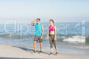 Sporting couple looking far away