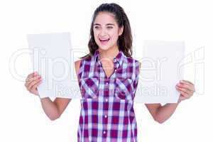 Pretty brunette looking at paper sheet